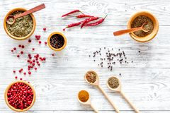 Variety of spices and dry herbs in bowls on wooden kitchen table background top view pattern Royalty Free Stock Photo