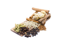 Variety of spices Fenugreek,Candlenut,cinnamon,clove,cardomom, blackpepper, whitepepper Royalty Free Stock Image