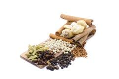 Variety of spices Fenugreek,Candlenut,cinnamon,clove,cardomom, blackpepper, whitepepper Royalty Free Stock Image