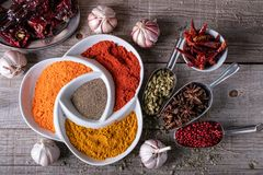 Variety of spices and herbs of exotic Indian colors, on the kitchen table. Variety of spices and herbs on the kitchen table stock photo