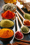 Variety of spices and herbs on kitchen table Stock Photos