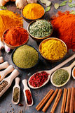 Variety of spices and herbs on kitchen table Stock Images