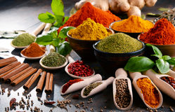 Variety of spices and herbs on kitchen table Stock Photo