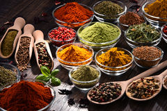 Variety of spices and herbs on kitchen table.  royalty free stock photos