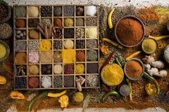 Variety of spices and herbs on kitchen table royalty free stock images