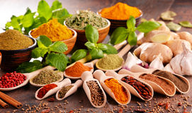 Variety of spices on kitchen table Royalty Free Stock Images