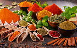 Variety of spices on kitchen table Royalty Free Stock Image