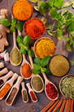 Variety of spices on kitchen table Stock Images