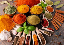 Variety of spices on kitchen table Stock Image