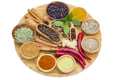 Variety of spices on wooden board Stock Photos