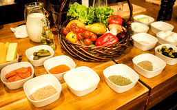 Variety of spices on wooden table Royalty Free Stock Photography