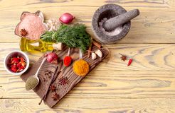 A variety of spices on a wooden table stock photo