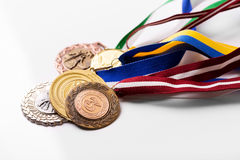 Variety of sport medals on white Stock Photos