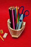 Variety of stationary in a wooden bucket Royalty Free Stock Photography