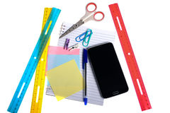 Variety of stationery items and a smartphone Stock Photos