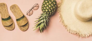 Variety of summer apparel items and fresh pinapple, wide composition stock images