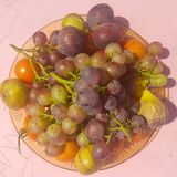 Variety of summer fruits against a pink background. Royalty Free Stock Images