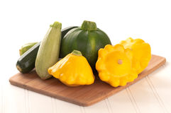 Variety of Summer Squash on White Background Stock Photo