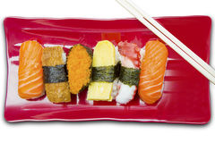 Variety sushi with chopsticks on white background Stock Images