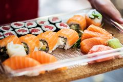 Variety of sushi in a delivery box royalty free stock photo