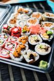 Variety of sushi in a delivery box royalty free stock image