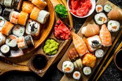 A variety of sushi, maki and rolls with ginger and soy sauce royalty free stock photography