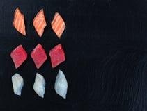 Variety of Sushi on natural slate stone background Stock Photography