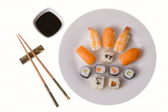 Variety of sushi rolls. Nigiri Sushi salmon and king prawn; California rolls and Makizushi. Soy sauce and chopsticks. Isolated on white Stock Photo