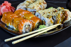 Variety of sushi rolls on a plate Stock Photo