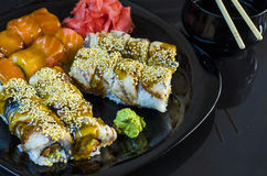 Variety of sushi rolls on a plate Royalty Free Stock Photography