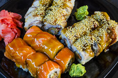 Variety of sushi rolls on a plate Stock Photography