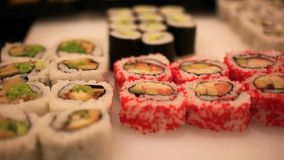Variety of sushi on shelves in supermarket In. Japan. Close up of macro with blurred background and bokeh stock footage