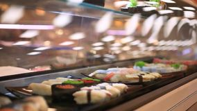 Variety of sushi on shelves in supermarket In. Japan. Close up of macro with blurred background and bokeh stock video