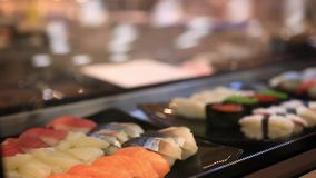 Variety of sushi on shelves in supermarket In stock video footage