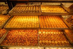 Variety of sweet Baklava, traditional turkish famous delicious dessert in tray showcase of local shop in Istanbul. Turkey Royalty Free Stock Photo