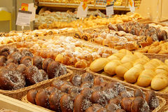 Variety of sweet buns at a supermarket Stock Images