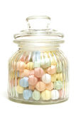 Candy Jar. A variety of tasty candies in cliche candy jar stock photo