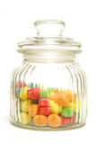 Candy Jar. A variety of tasty candies in cliche candy jar royalty free stock photo