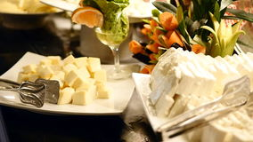 Variety of tasty delicious cheeses. In a hotel buffet in slow motion stock video