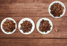 Variety of coffee beans on rustic wooden background royalty free stock image