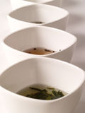 A variety of teas. In white pots on a white background Stock Photography