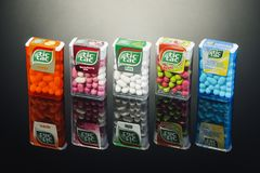 Variety of Tic tac drops isolated on gradient background. Royalty Free Stock Photo
