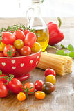 Variety of tomatoes and pasta Royalty Free Stock Photos