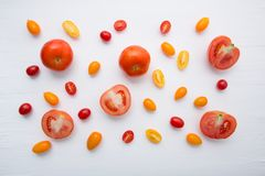 Variety tomatoes on white wooden Royalty Free Stock Image