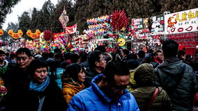 Variety of toy stands and the visitors at Ditan temple fair during Spring Festival in Beijing, China.  stock footage