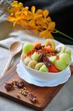 Variety Tropical Fruits on Yogurt Bowl. Variety tropical fruits and pecan on yogurt bowl for healthy breakfast royalty free stock images