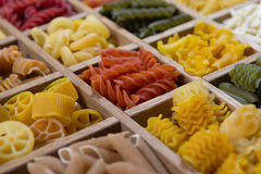 Variety of types, colors and shapes of Italian pasta. Dry pasta royalty free stock image
