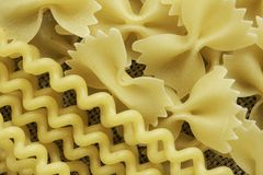 Close of uncooked macaroni. Variety of types and shapes of dry Italian pasta Stock Photo