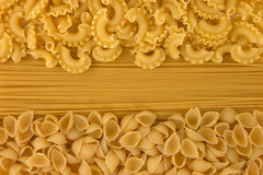 Variety of types and shapes of dry Italian pasta royalty free stock photography