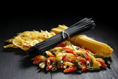 Variety of types and shapes of Italian pasta Stock Images